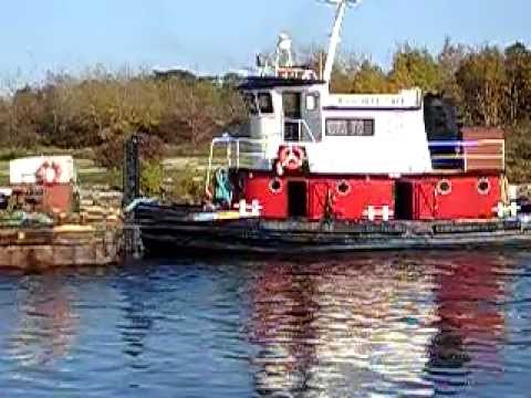Tug Boat transferring dredged material in U.P. Michigan