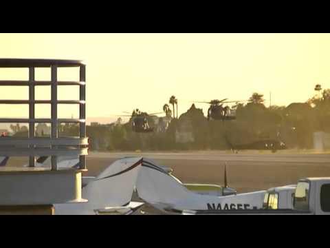 3 Sikorsky UH-60 Black hawks landing at Santa Monica airport