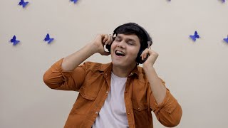 Young cute teenager listening to music in wireless headphones - lifestyle concept