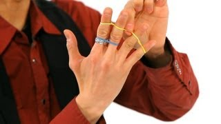 How to Do the Jumping Rubber Band Trick   Magic Tricks