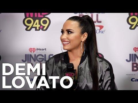 Demi Lovato talks with JV and Selena backstage at The WiLD 94.9 Jingle Ball 2017