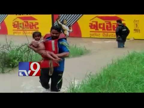 Heavy rains in Gujarat triggers flood like situation, 15 rescued - TV9