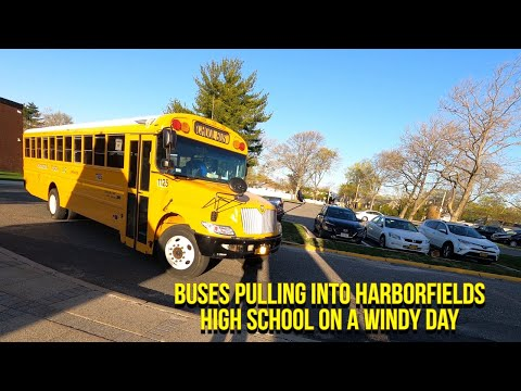 Buses pulling into Harborfields high school on a windy day
