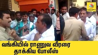 Ex-serviceman slapped by policeman outside bank | Latest Tamil News