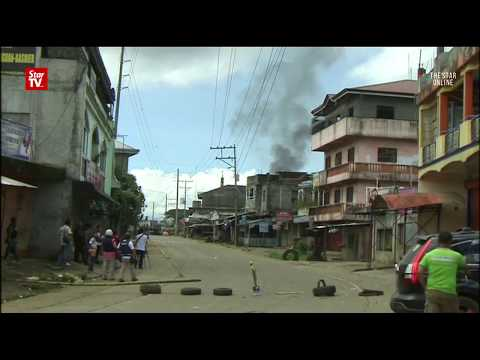 Islamist militants kill civilians in fighting with Philippine forces Mp3