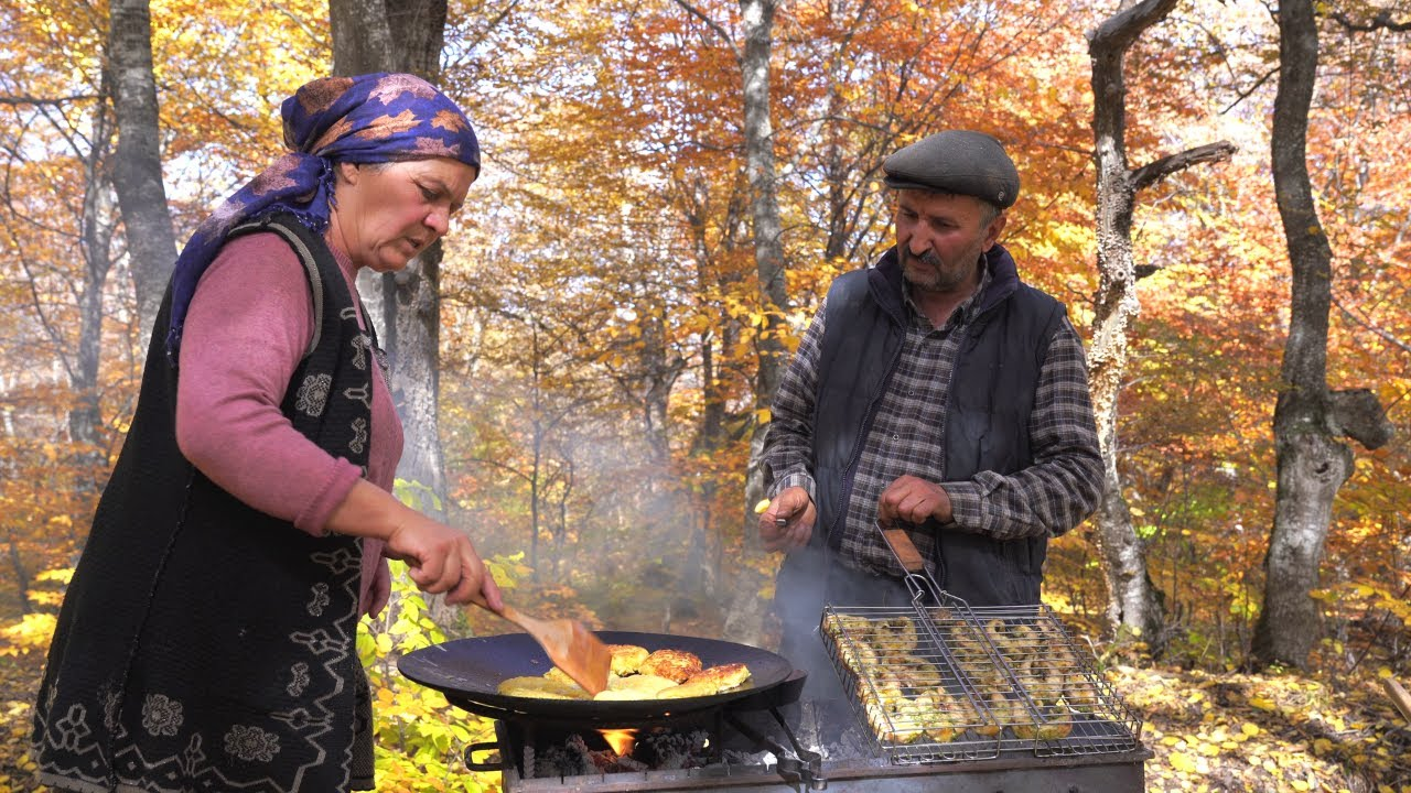 Download Cooking Whole Sturgeon Fish on Charcoal in the Forest