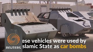 Iraqi police parade vehicles used by Islamic State as car bombs