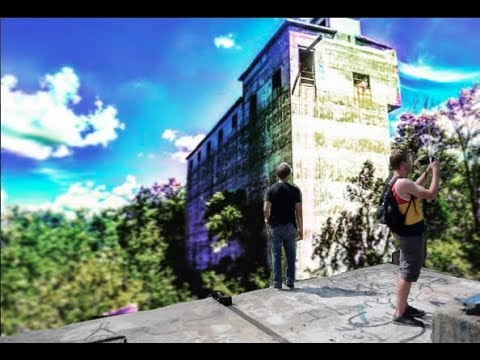 ABANDONED CEMENT PLANT! Explored! (Secret Rooms Under River, I jump off a building!)