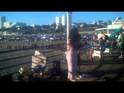 Lana singing at Santa Monica Pier to Madison from Madison Media Radio