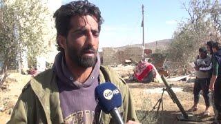 أخبار عربية | مجموعة من الجيش الحر يتصدون للنظام ويعيدون بناء ما دمره