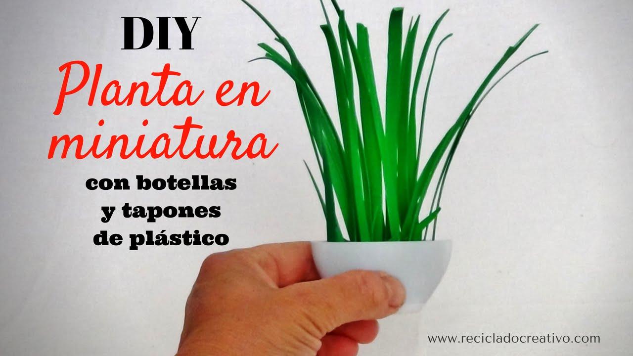 C mo hacer una planta en miniatura con tapas y botellas de for Plantas de plastico para decoracion