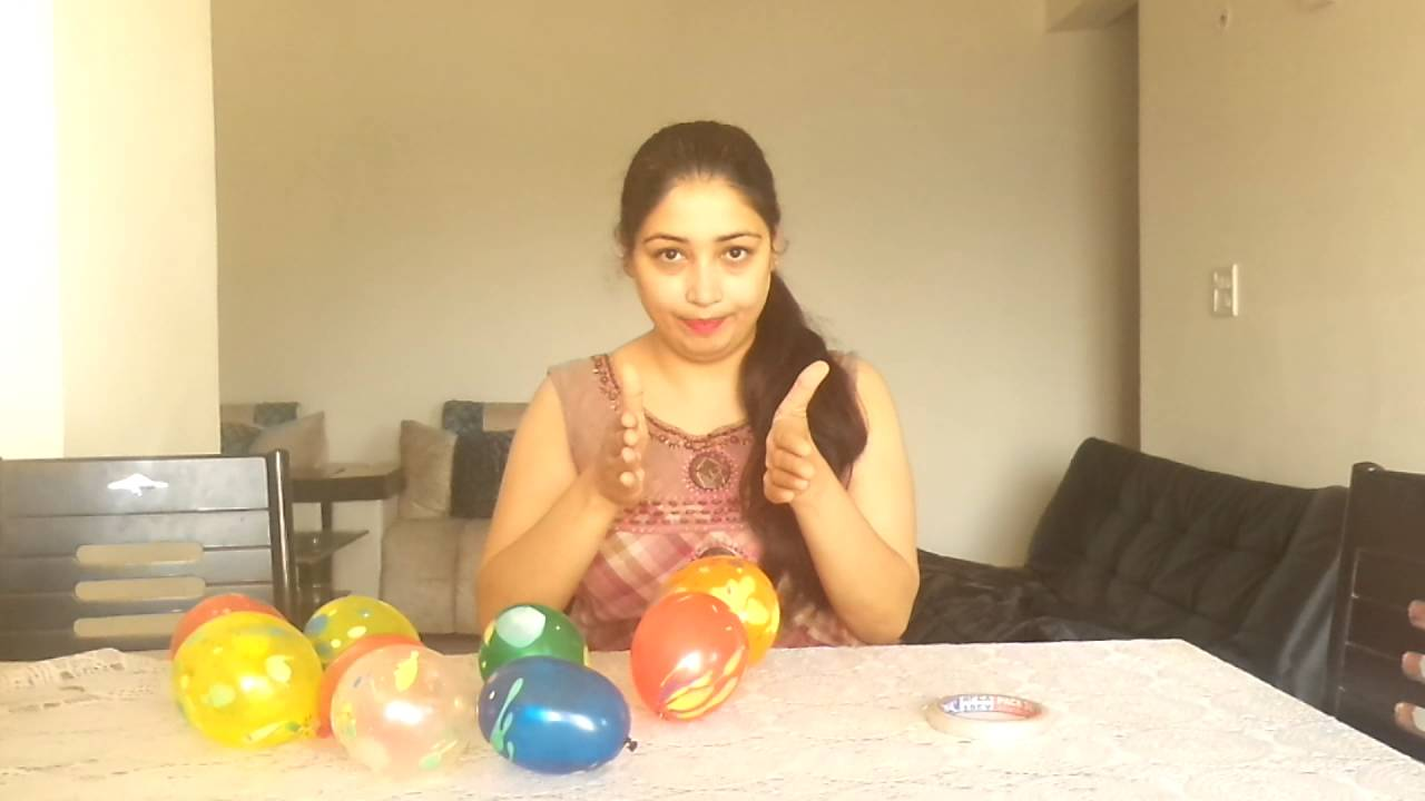 One minute holi game for ladies kitty party balloon for Balloon party games