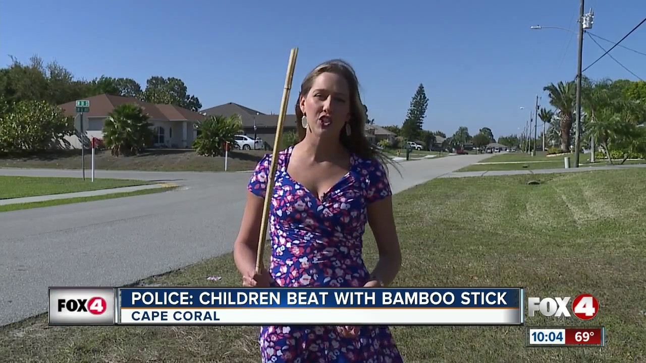 Father beats kids with bamboo stick