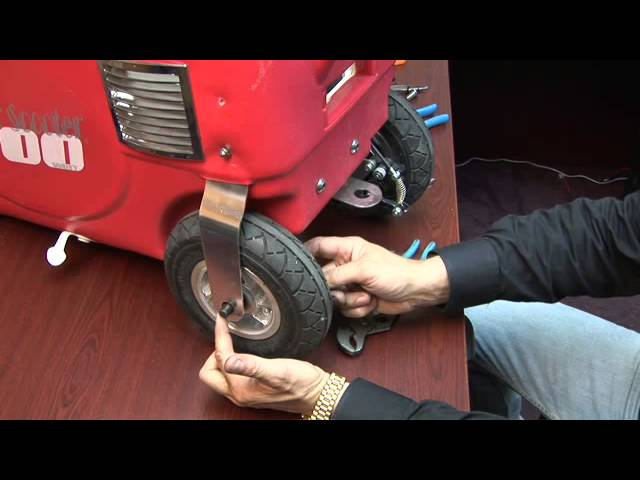 Breaking down rear end and left tire removal and reinstallation