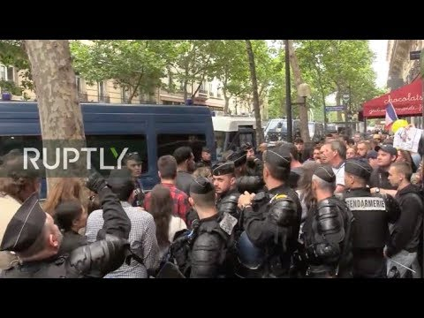 : Anti-government protesters gather in Paris on Bastille Day