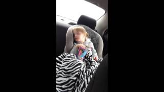 Toddler is eating while falling asleep in the car! Too cute!