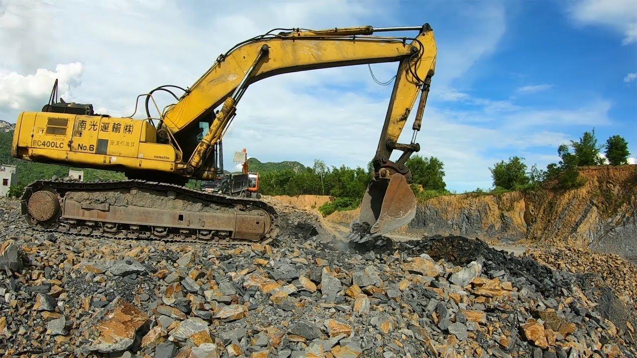 Large Excavator Komatsu And Dump Truck Working In Quarry Mine