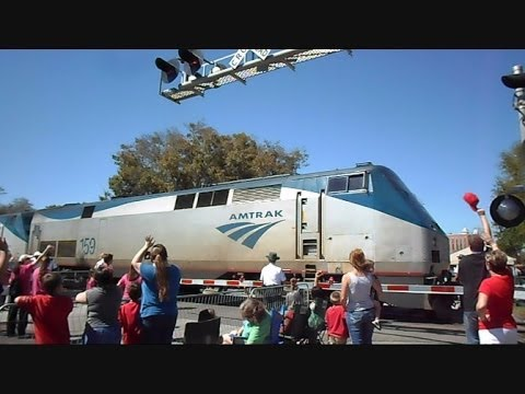 Thumbnail: Amtrak Train Separates Strawberry Parade In Half