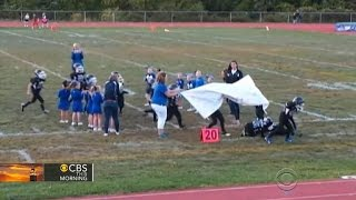 Mighty Mite football players struggle to break through banner