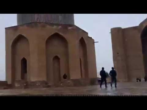 a mosque, the Yasaui Mausoleum, and snow in Turkistan, Kazakhstan