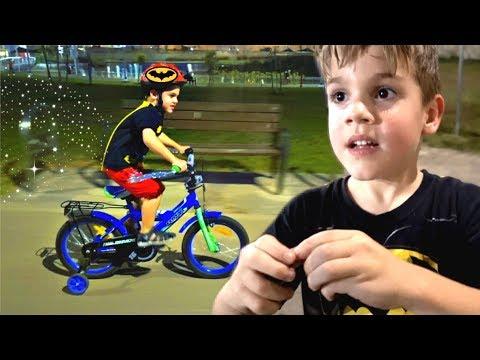 Batman Kid Rides a Bike at Night