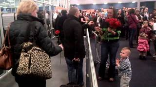 Arrival hall engagement - Abbotsford Airport wedding proposal - WestJet