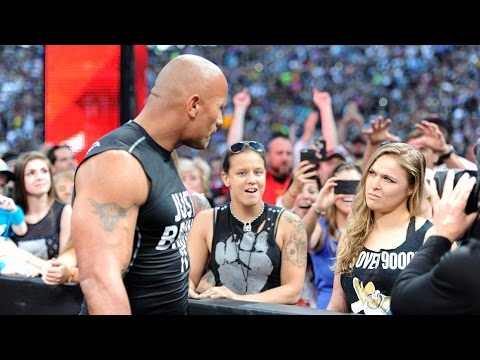 The Rock and Ronda Rousey make surprise appearance at WrestleMania 31.Watch Video