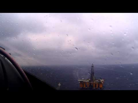 Helicopter flight into the Gulf of Mexico. [ Life in the Oil Field Skies by Don Brand ]