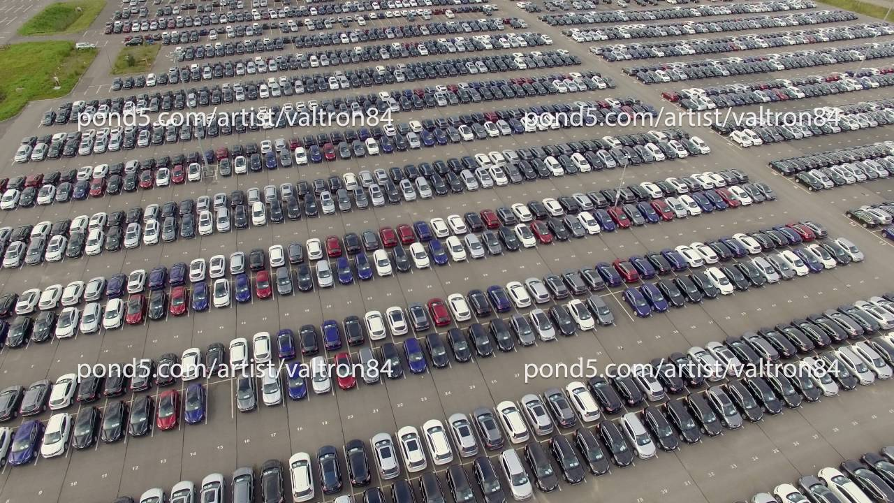 Flying Above Storage Parking Lot Of New Unsold Cars Aerial View
