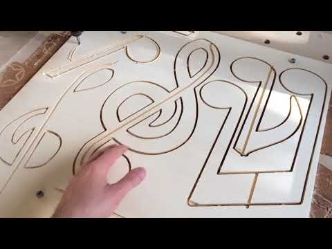 Cutting musical notes pendants