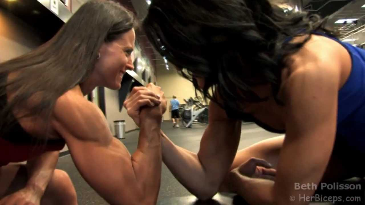 Two muscle women play with double dildo 5