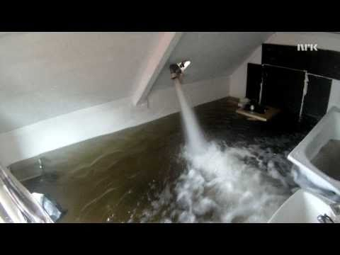 Collapsing floor by filling room with water