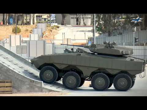 Watch: The First Wheeled Eitan APC With A Turret-Mounted Gun