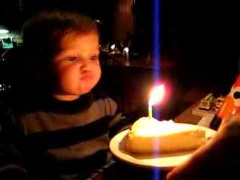 Baby Trying Hard To Blow Out Birthday Candles