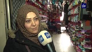 أبناء غزة يلجؤون إلى الملابس المستعملة لسد احتياجاتهم - (13-2-2019)