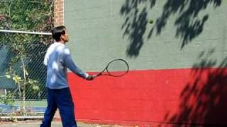 practice tennis volley against wall