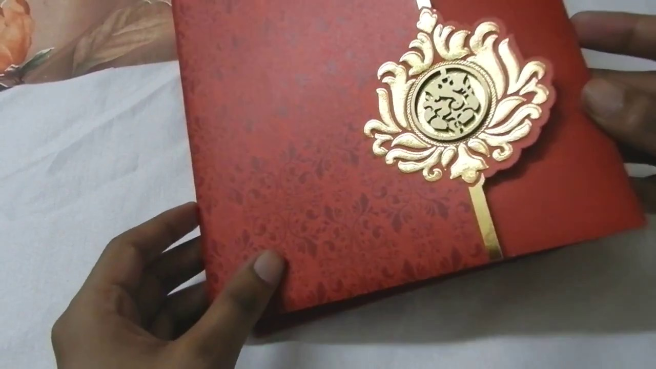 Beautiful Red Golden Wedding Invitation with Die Casting Ganesha ...