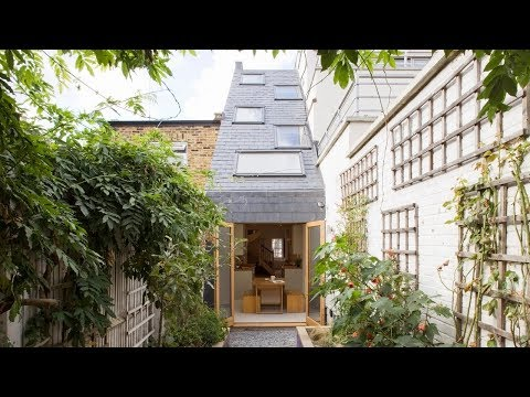 Narrow house has large sloped roof to increase natural light