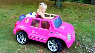 Playing in the Park on the Pirate Ship Playground for Kids Pink Car Ride on Power Wheels & Baby Doll thumbnail