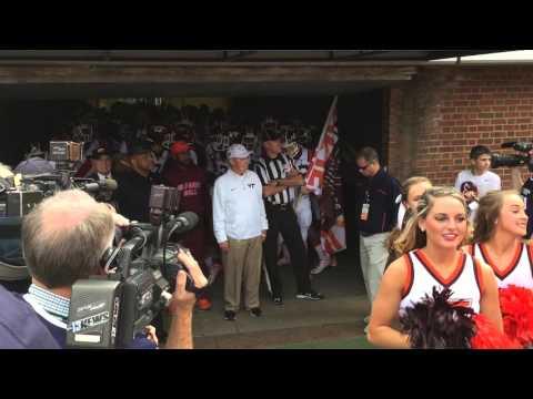Frank Beamer leads Virginia Tech onto the field against Virginia