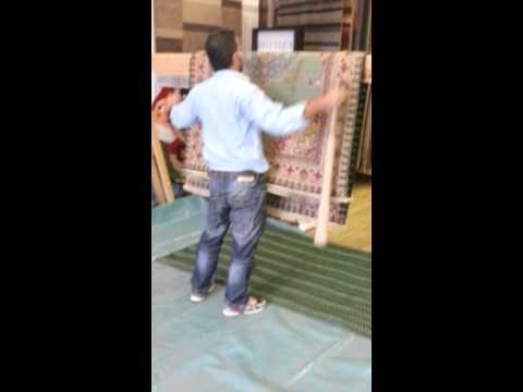 Dusty Kerman rug beating