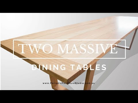 a very modern and very large pair of dining tables - 14 seater dining tables