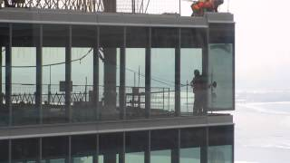 TO High Rise-construction workers installing window on 38th flr Part2