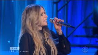 Avril Lavigne sings