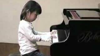 5-yr-old Ethel Performing on Piano in Concert