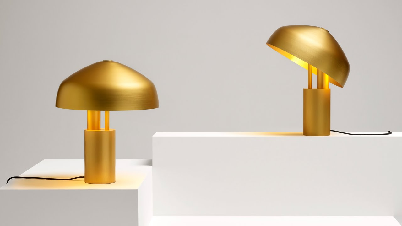 Aura Desk Lamp By Ross Gardam Features A Rotating Gold Shade