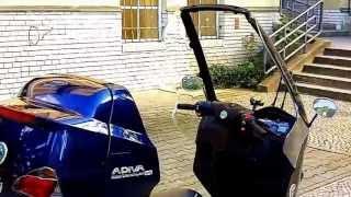 Regenschutz, die Benelli adiva der Roller, mit dem man trocken durch den Regen fahren kann