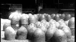 Manufacturing  mortar shells and filling them with explosives at a plant in Italy HD Stock Footage