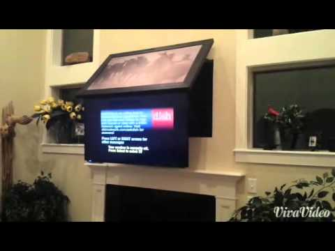 This Hidden Vision (tm) TV mount hides a TV above the fireplace behind a picture frame. When opened it lowers the TV to a better viewing position.