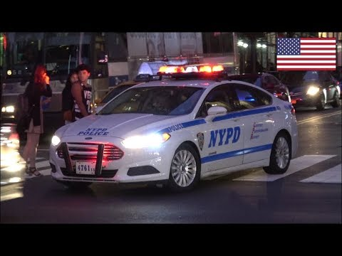 NYPD Police car responding with horn, manual siren and lights